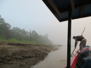 Boat in fog on Manu River
