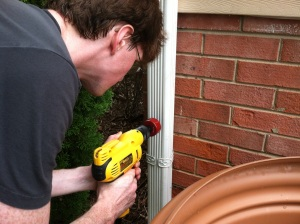 Drilling the hole in the gutter for the rainbarrel