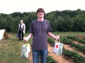 Chris with bags of apples in Maryland
